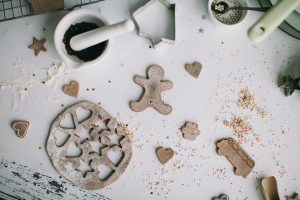 medical clinic calgary holiday blog header with image of gingerbread cookies being baked